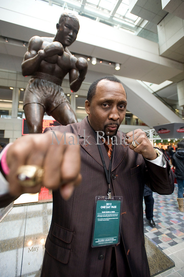 "Legendary boxer Tommy ""The Hitman"" Hearns stands beneath a statue of Joe Louis inside Cobo Hall during the auto show in Detroit, MI on Jan 20, 2012."
