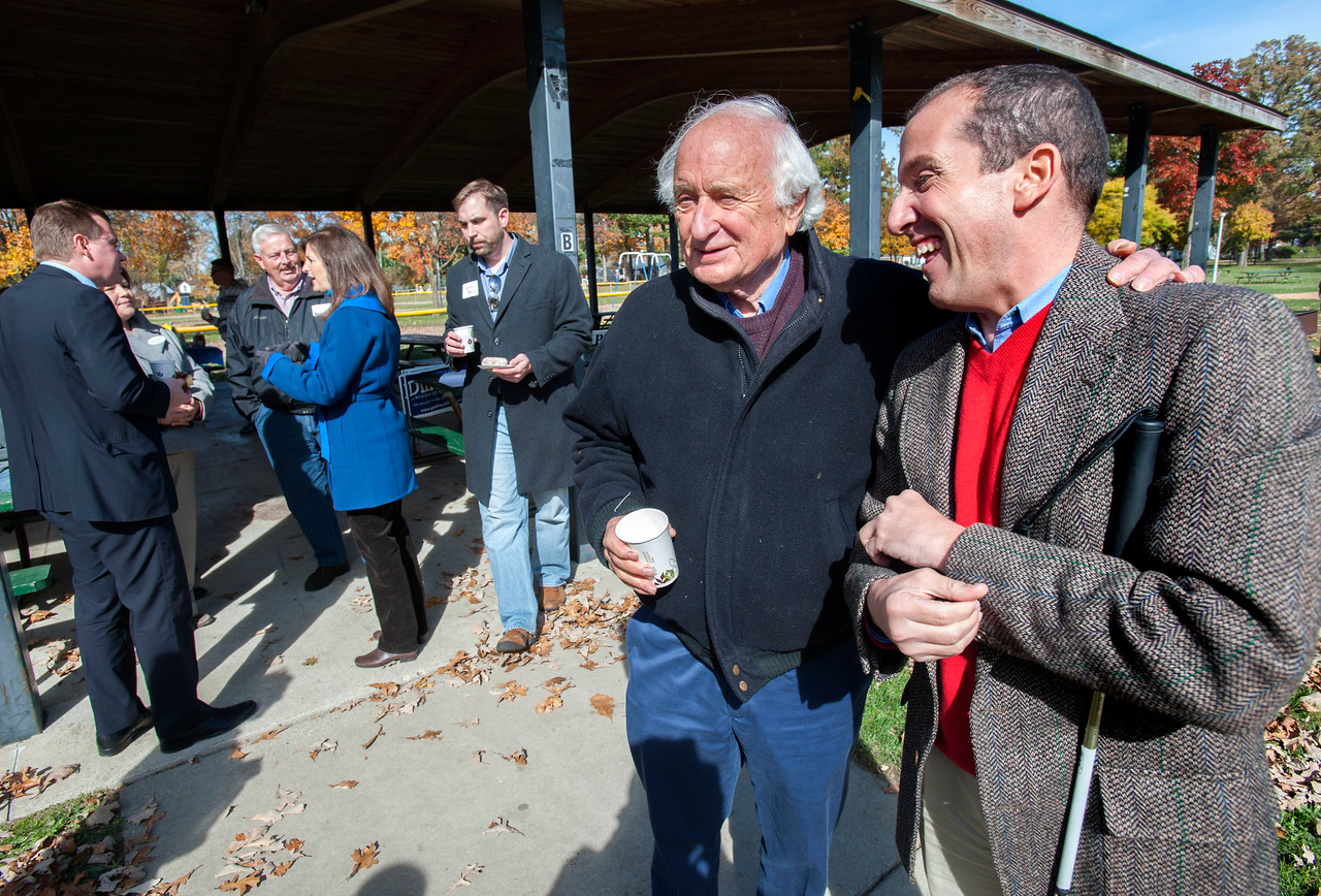 CAPTION INFORMATION Congressman Sandy Levin talks to Richard Bernstein, right, at a democrat campaign stop at Clawson City Park on Oct 19, 2014.  (Mark Bialek / Special to the Det News)