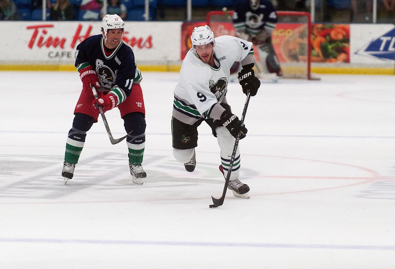 CAPTION INFORMATION Dallas Stars center Tyler Seguin takes the puck past Ottawa Senators center David Legwand during an Alumni Game at Compuware Arena on Aug 16, 2014.  (Mark Bialek / Special to the Det News)