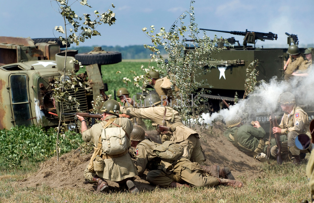 A World War II reenactment takes place during the Yankee Air Museum's Thunder over Michigan Air Show in Ypsilanti, MI on Aug 4, 2012.  In this scene, American soldiers are about to be overrun.  (Mark Bialek / Special to the Det News)