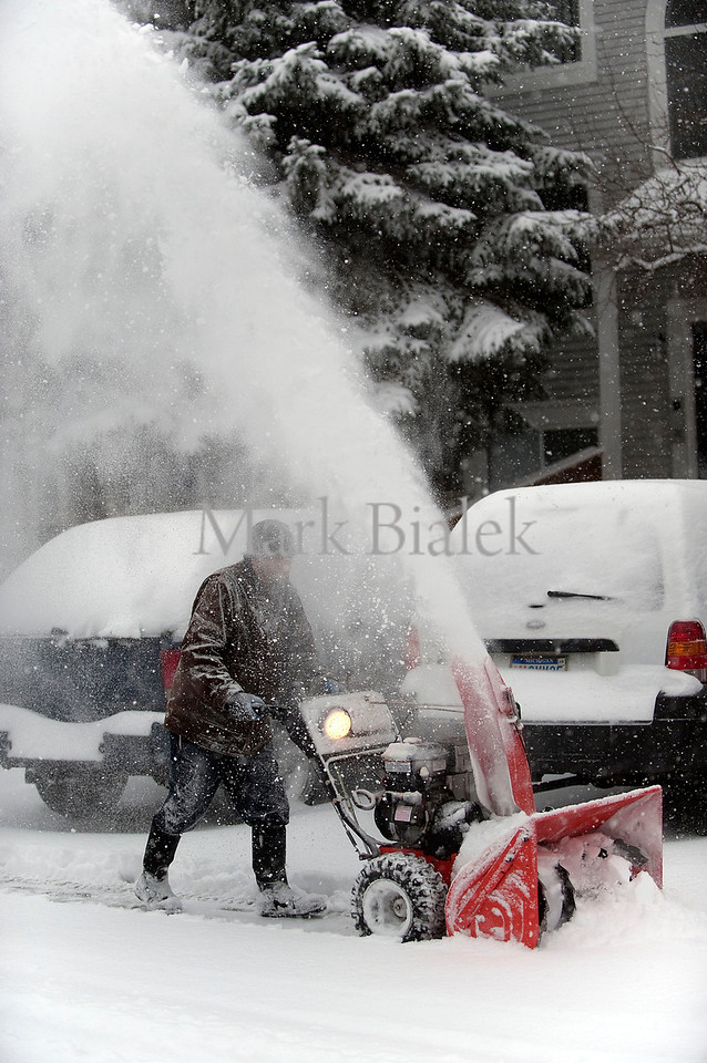 John Grucz clears snow for residents at an apartment complex in Whitmore Lake, MI on Dec 26, 2012.  Michigan residents got their white Christmas a day late.