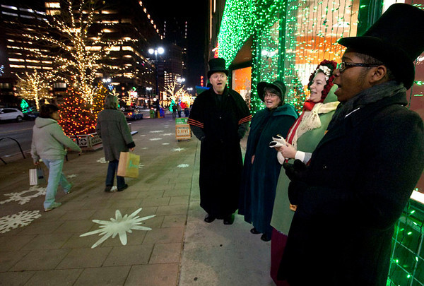 A group called The Festival Singers sing Christmas Carols as people shop along the Woodward Avenue CityLoft stores in downtown Detroit, MI on Nov 17, 2012.  The singers, from left, are Chris Lynch, Susan Wentworth-Hoben, Laurie Gebert, and Brian Baylor.  (Mark Bialek / Special to the Det News)  Mark Bialek is a freelance photojournalist in the Ann Arbor, MI area.