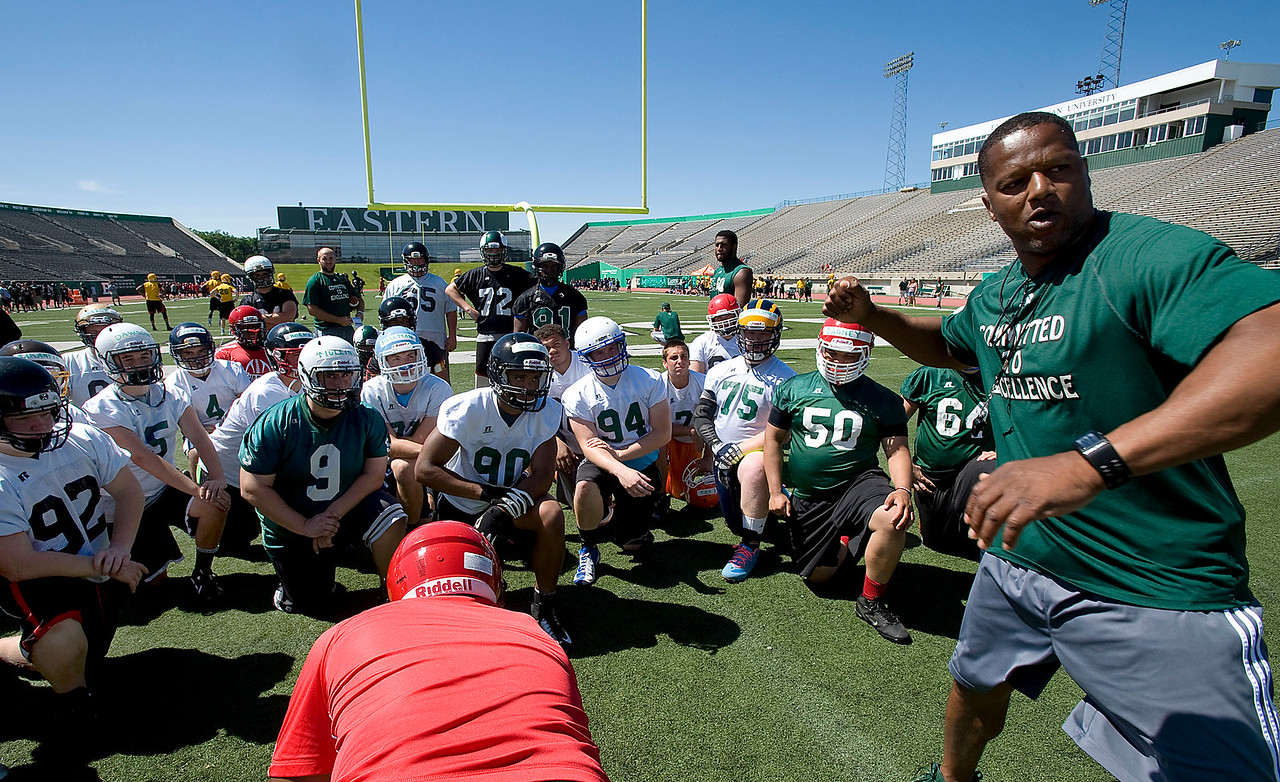 CAPTION INFORMATION EMU defensive line coach Jimmy Williams works with high school football players during a 7 on 7 tournament at Eastern Michigan University's Rynearson Stadium on June 21, 2014.  (Mark Bialek / Special to the Det News)
