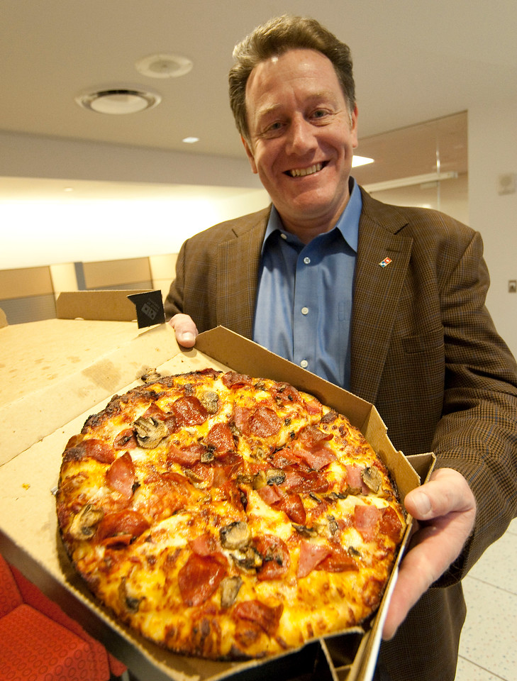 Domino's Pizza CEO J. Patrick Doyle poses with a pan pizza at the Domino's headquarters in Ann Arbor, MI on Jan 31, 2013.