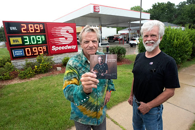 "Randy Tessier holding his CD ""Sugar Town,"" and writer Jim Leonard, at the Speedway on Stadium Blvd.  (Photo by Mark Bialek)"