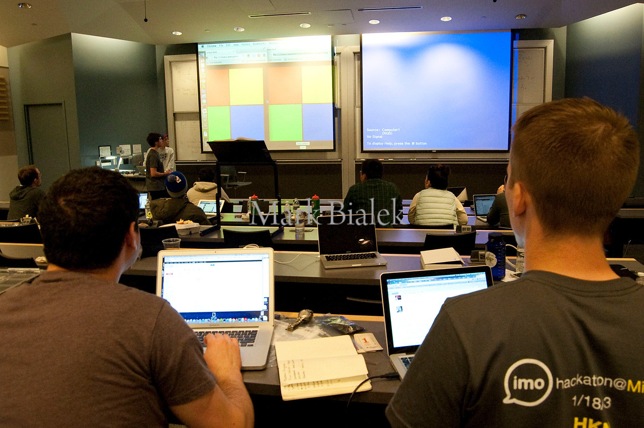 University of Michigan students Mitch Adler, left, and Andrew Copp watch as a team makes their presentation to imo.im judges at the culmination of a 22-hour 'Hackathon' on the University of Michigan's North Campus on Jan 19, 2013.  The event sponsor, Silicon Valley startup imo.im, is looking for talent for its growing online business.  http://blog.imo.im/2013/01/imo-spends-weekend-in-michigan-for.html
