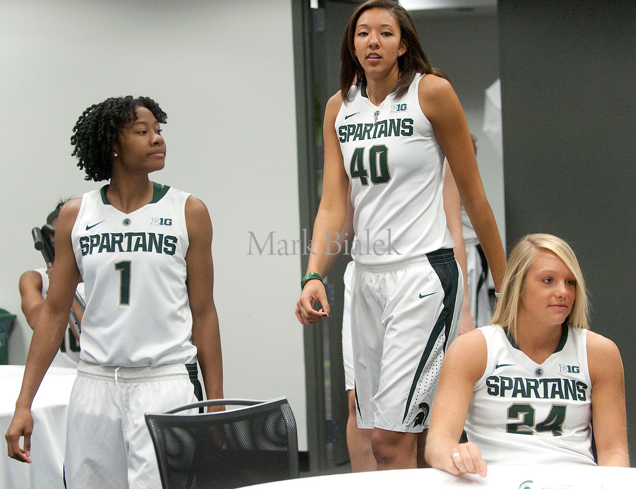 From left, Jasmine Thomas, Madison Williams, and Courtney Schiffauer get ready for interviews during the Michigan State University women's basketball media day at the Breslin Center in East Lansing, MI on Oct 8, 2012.  (Mark Bialek / Special to the Det News)