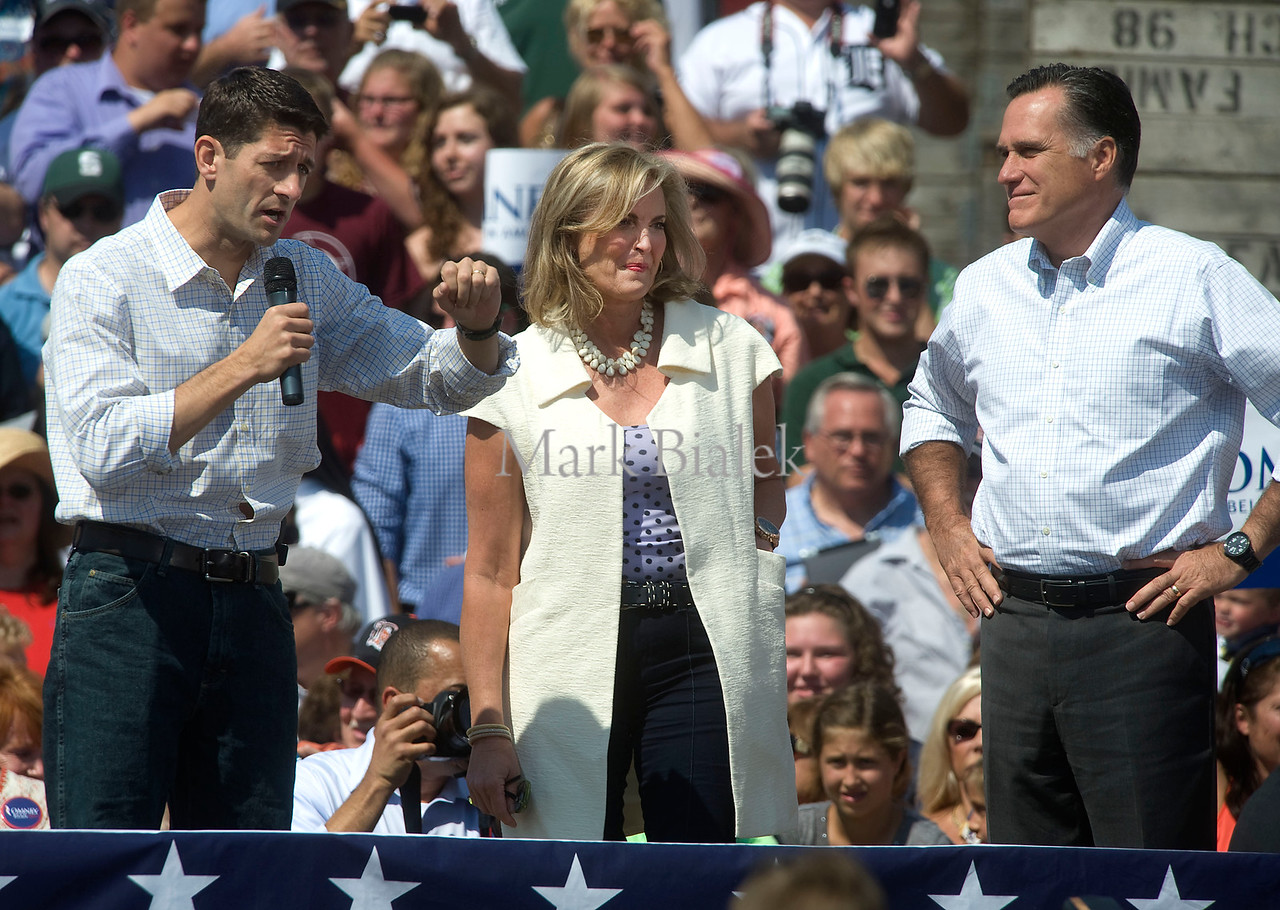 Vice presidential candidate Paul Ryan speaks next to Ann and Mitt Romney during a campaign stop in Commerce Township, MI on August 24, 2012.