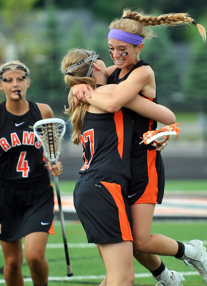 CAPTION INFORMATION Rockford's Grace Gunneson celebrates with Alex VanderMolen (headband) after beating Birmingham United, 14-9, in the division 1 state semifinal game in Brighton on June 4, 2014.  They advance to the MHSAA final on June 7.  (Mark Bialek / Special to the Det News)