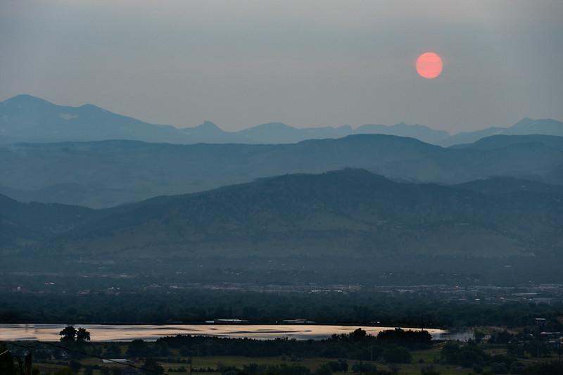 Sunset against western wildfire haze