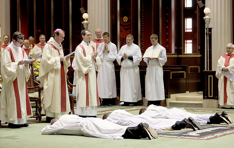 The Most Reverend Archbishop Dennis Schnurr prays as the ordinands prostrate themselves during the Ordination of Priests at the Cathedral of Saint Peter in Chains in Cincinnati Saturday, May 20, 2017. (CT Photo/E.L. Hubbard)