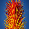 """""""Scarlet and Yellow Icicle Tower""""  ( <a href=""""https://chihuly.nybg.info/view/scarlet-and-yellow-icicle-tower/7b432c40-850b-ed20-788b-18446cad24d2"""">https://chihuly.nybg.info/view/scarlet-and-yellow-icicle-tower/7b432c40-850b-ed20-788b-18446cad24d2</a>)"""