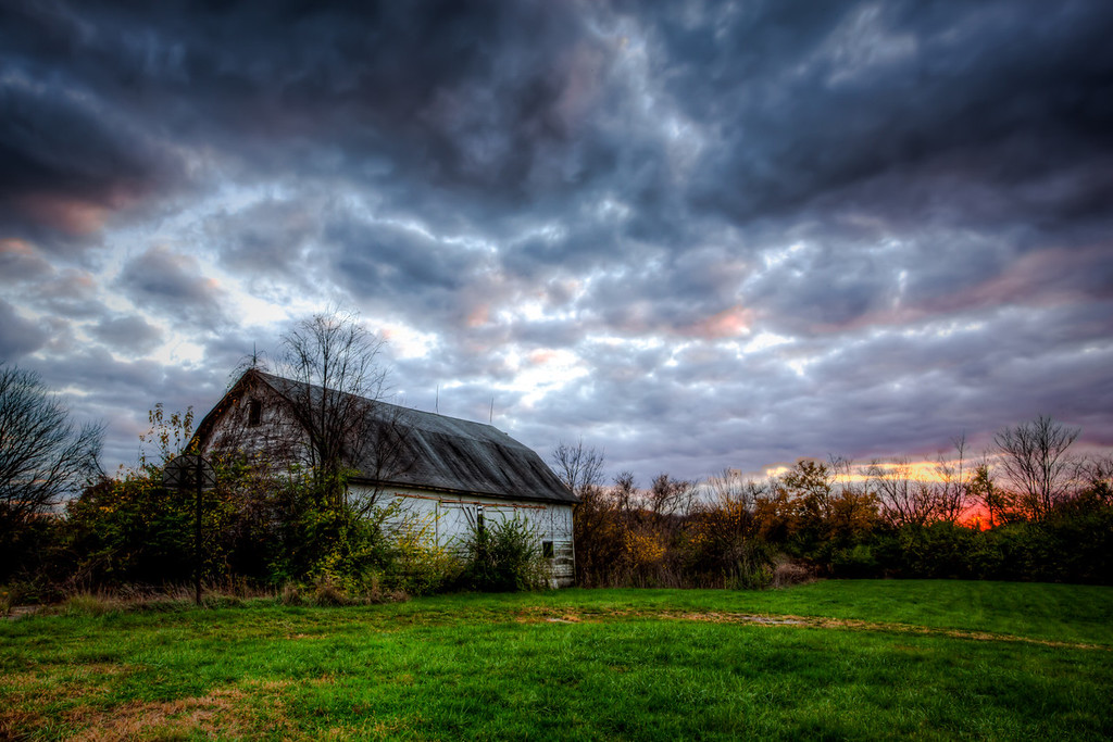 "Went out with the kids to shoot a church and steeple. Did not find much there so hopped in the car as the sun was quickly setting. I had a specific spot in mind and I was rushing to get there, looked at this barn as we drove by to the other place and quickly stopped and finished the night here. Who thinks there was a no trespassing sign there??<br /> <br /> Check out more at  <a href=""http://www.photoitsu.com"">http://www.photoitsu.com</a>"