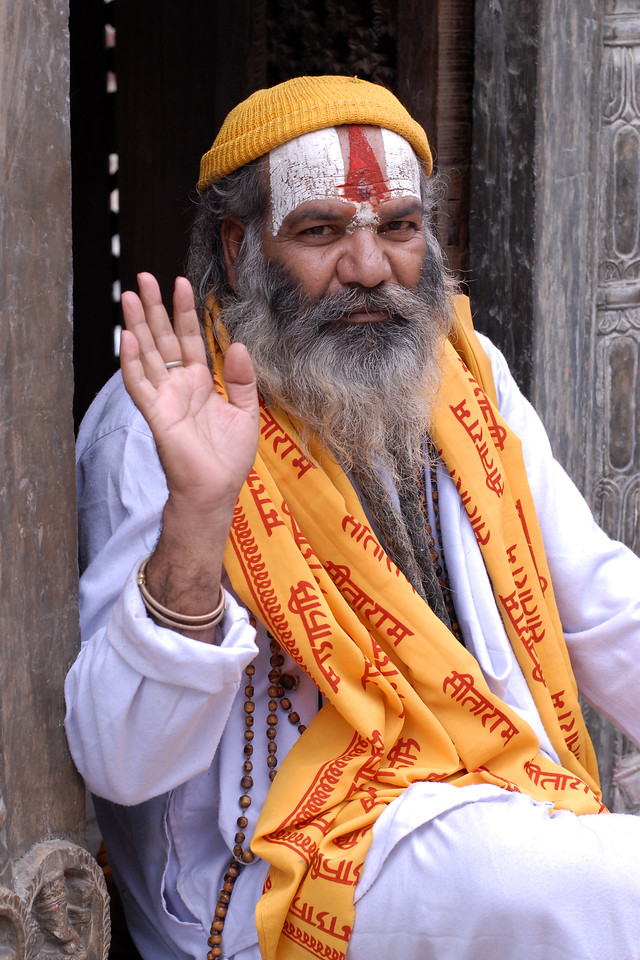 Sadhu (medicant) with sash saying the name of the Lord Sita-Ram. Sitting near Pashupatinath Mandir, Kathmandu, Nepal these sadhus wait at the temple gates and ask for offerings from devotees. Not all of them are true seekers and some are just dressed up to collect money from innocent people.