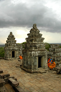 Monks at Sunset point in Siem Reap near the Angkor Wat Temple Complex. A storm with rain clouds appeared on the horizon.