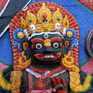 Kala Bhairava deity of Newars, with string of skulls at Durbar Square, Kathmandu, Nepal.