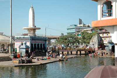 Ghats (river banks) of the Godavari at Nashik. It is believed that all the Sins are washed out by taking Holy dip in the Kundas (Ponds) constructed in the river. Also by performing the last rites, Moksha is attained by the deseased soul. The river in the Ramkunda (Pond) flow from North to South, hence the river becomes Dakshin Wahini i.e. flowing towards South. This gives the Ramkunda a unique place or religious importance. Almost daily 3 to 5 thousand pilgrims come and take Holy dip on the ghats.