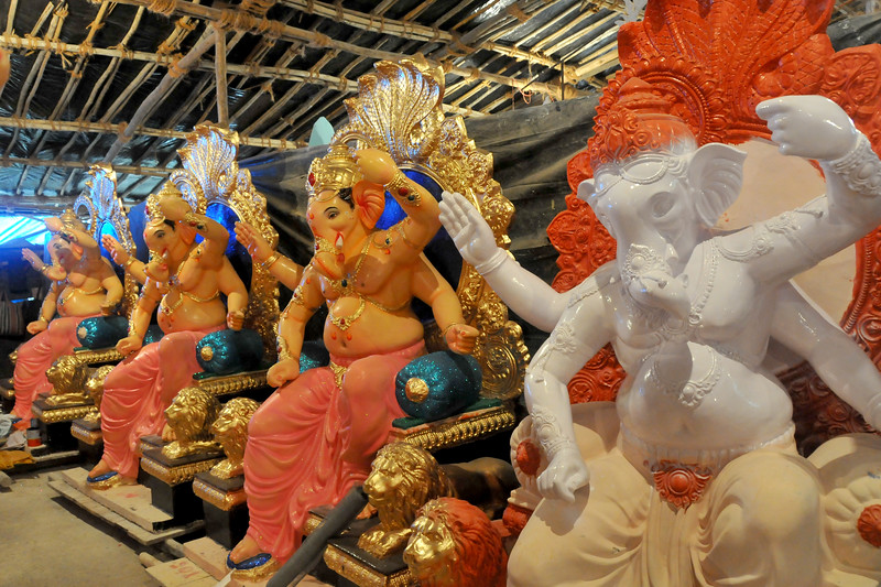 Artists make and paint Ganesh idols and other murthis (statues) which are for sale on the eve of the Ganesh Chaturti festival in Lower Parel, Mumbai.