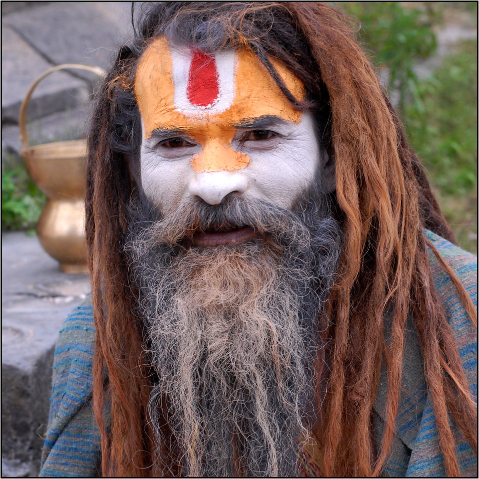 "Ash and colour smeared Sadhu (medicant) with his ""lota"" (the pot behind) and ""kamandal"" near Pashupatinath Mandir, Kathmandu, Nepal."