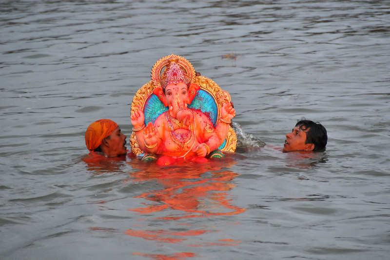 Giant idols of elephant-headed Hindu God Ganesha being taken to Powai Lake in Mumbai, with beating of drums and grand celebrations for the Ganesh Chaturti festival.