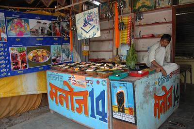 Outside Shani Temple the various puja samagri (assorted religious items) being sold. Shri Shani Dev Sthan near Nashik, Maharashtra, India