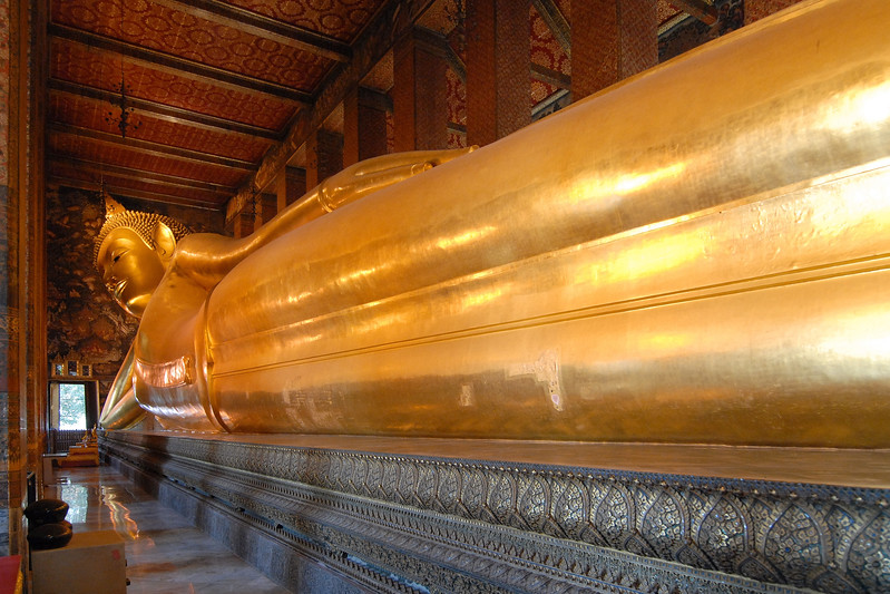 "WAT PHO (Recline Buddha) is one of Bangkok's oldest and largest temples. Wat Pho was built by King Rama I nearly 200 years ago and houses the gigantic gold-plated Reclining Buddha. WatPho is also regarded as the first centre of public education and is sometimes called ""Thailand's First University""."