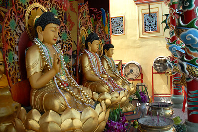 Statues of Lord Buddha seated on lotus in a Buddhist temple in Ayuthaya, Thailand.