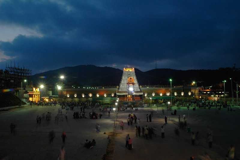 Sri Venkateswara Temple in the evening. Tirumala Tirupati dev sthanam.  The ancient and sacred temple of Sri Venkateswara is located on the seventh peak, Venkatachala (Venkata Hill) of the Tirupati Hill, and lies on the southern banks of Sri Swami Pushkarini. <br /> It is by the Lord's presidency over Venkatachala, that He has received the appellation, Venkateswara (Lord of the Venkata Hill). He is also called the Lord of the Seven Hills.<br /> <br /> The temple has its origins in Vaishnavism, an ancient sect which advocates the principles of equality and love, and prohibits animal sacrifice.<br /> <br /> The sanctum sanctorum which houses the awe-inspiring idol of the Lord of the Seven Hills is situated in the main temple complex of Tirumala.