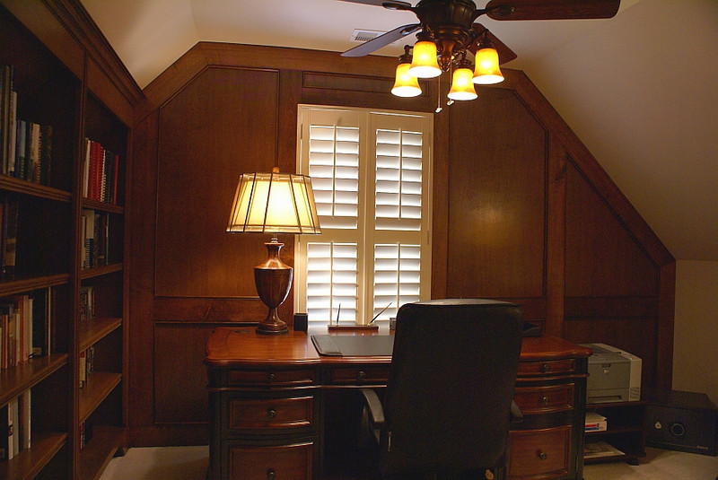 Office/study:<br /> <br /> Attic kneewall at right was relocated for more floorspace.<br /> Wood judge's paneling and baseboards to coordinate with built-in bookcases were addded for warmth and elegance.