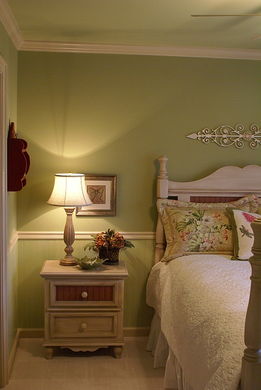 Guest bedroom:<br /> <br /> Beadboard wainscotting and doors were added, then painted soft green tones for a calming cottage feel.