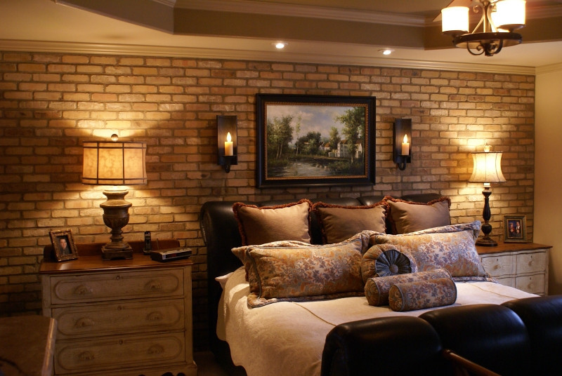 Master Bedroom:  <br /> <br /> Brick veneer wall was added for warmth and texture.  Dimmable electric candle wall sconces and adjustable can lights for bedtime reading were added and switched seperately at bedside for relaxed evening wind down time.