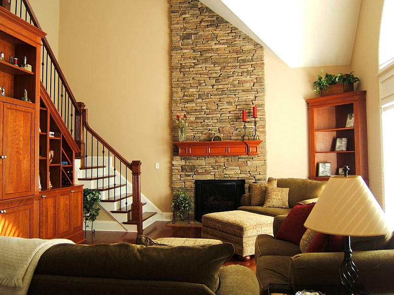 Family Room Remodel: <br /> <br /> New hardwood flooring, stair treads & railing, cultured stone fireplace, new french door entry to deck, cherry mantle & cabinetry.
