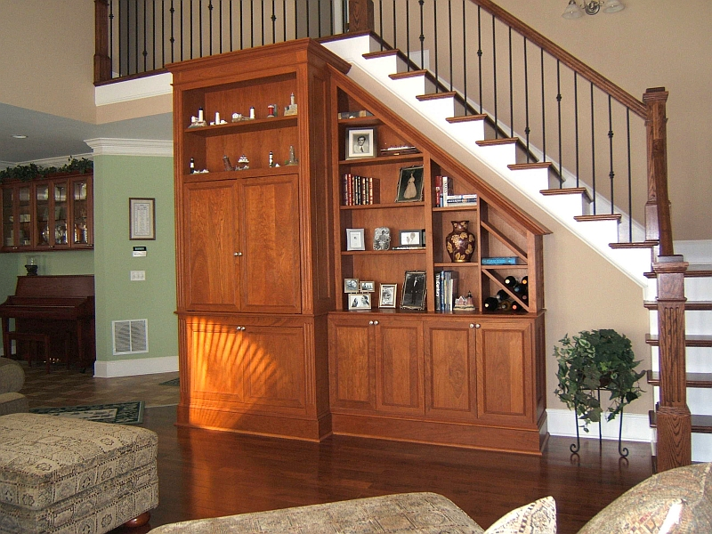 Family Room Remodel:<br /> <br /> New cherry media storage cabinetry, hardwood flooring, stair treads & railing.