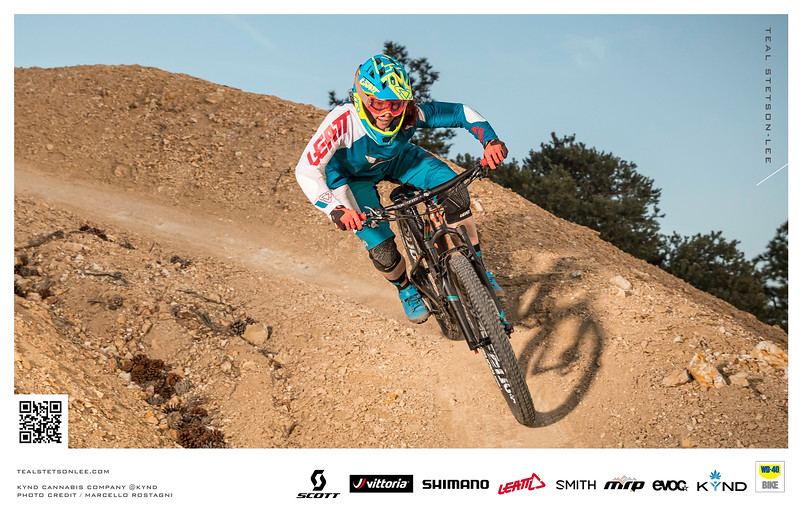 Action sports advertisement photography of professional mountain biker going downhill.