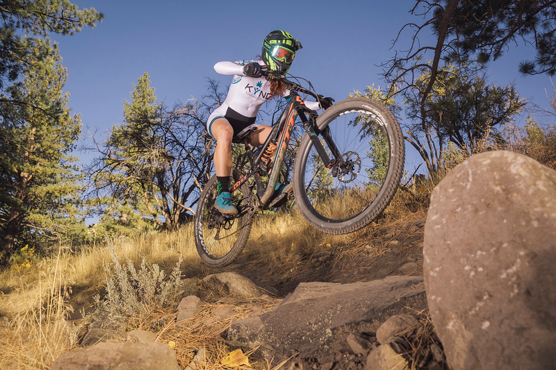 Advertisement photography of sponsored KYND Cannabis athlete mountain biker Teal Stetson Lee.