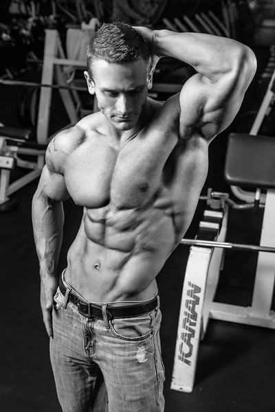 Fitness Photography of male bodybuilder in the gym.