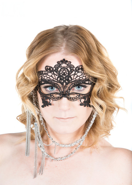 Boudoir and Glamour photographer Marcello Rostagni photographs a portrait of a woman wearing an italian mask in his Reno, NV photography studio.