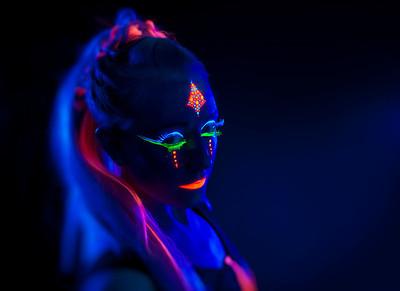 Reno Photographer Marcello Rostagni photographs model in his Reno Studio using UV lights and UV reactive clothing/makeup.