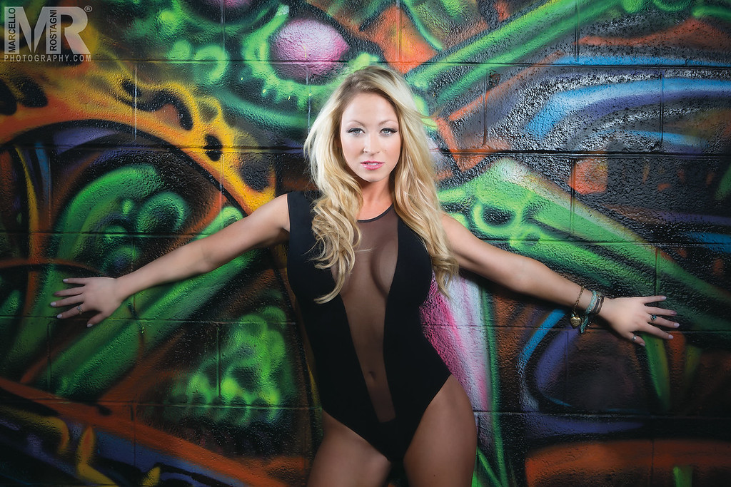 Reno Photographer Marcello Rostagni photographs a model in front of beautiful painted mural on wall in downtown Reno NV.
