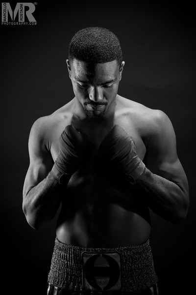 Portrait of boxer praying by Reno photographer Marcello Rostagni.