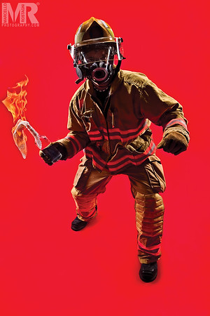 Reno Photographer photographs a portrait of firefighter holding a molotov cocktail using strong juxtaposition.