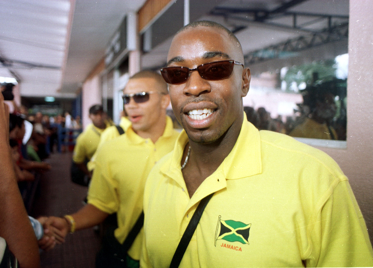 Linval Dixon (R) and several teammates leave the Tegucigalpa airport upon arrival in the Honduran capital September 3, 2001. The Jamaicans will play Honduras this Wednesday in a World Cup Qualifying match. Jamaica lost 2-1 against Mexico on Sunday.  REUTERS,/ Adam Bernstein