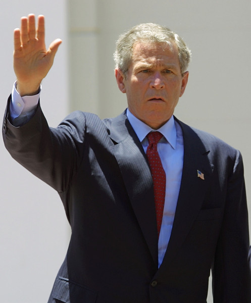 George Bush waves to photographers after arriving at the Presidential Palace March 24, 2002 in San Salvador, El Salvador. Bush passed through San Salvador after stops in Monterrey, Mexico and Lima, Peru. REUTERS,/ Adam Bernstein