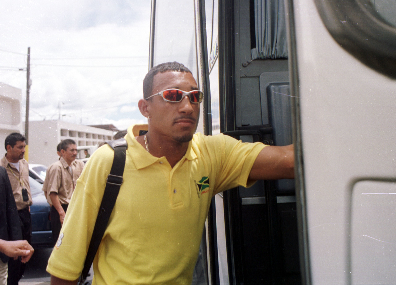 Tyrone Marshall of the Jamaican national soccer team boards an awaiting bus upon arriving in the Honduran capital Tegucigalpa September 3, 2001. The Jamaicans will play Honduras this Wednesday in a World Cup Qualifying match. Jamaica lost 2-1 against Mexico on Sunday.  REUTERS,/ Adam Bernstein