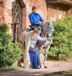 Spectacular  PRE Stallion Jalisco Garrocha , owned by Mariluz Duende, ridden by Tomas Santiago Solana,  with dancer Mariluz García, in front of the Castle and Monastery at  Escornalbou, Spain