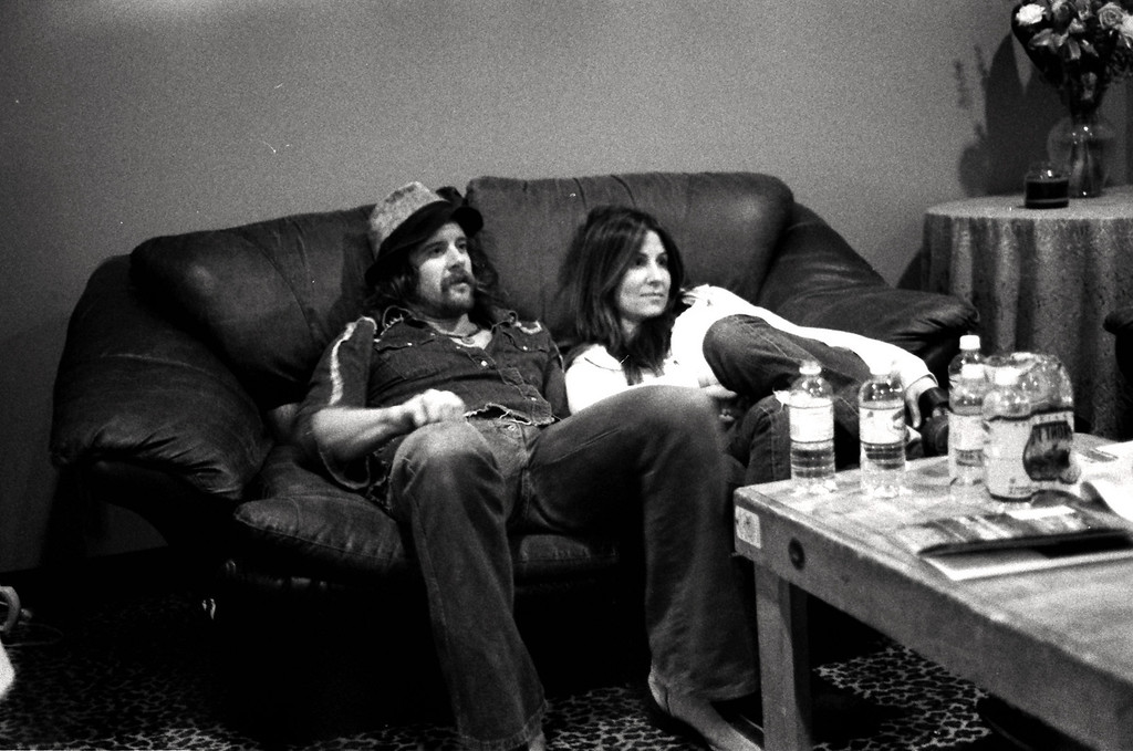 Donovan Frankenreiter and friend sitting backstage after a show.