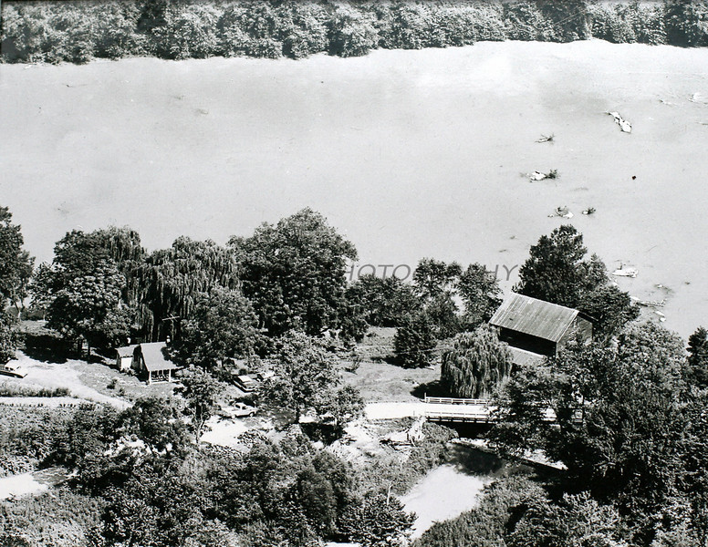 Though not in the village of Rockford, Bohannon Mill (building on the right) sits across the river from Rockford and played an instrumental part of the daily life of the people who lived in Rockford and the surrounding area. The building on the left is the home occupied by the miller. Neither structure is still standing.