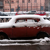 RED CAR COVERED IN SNOW. NAB KRYUKOVA KANALA. ST. PETERSBURG. RUSSIA.