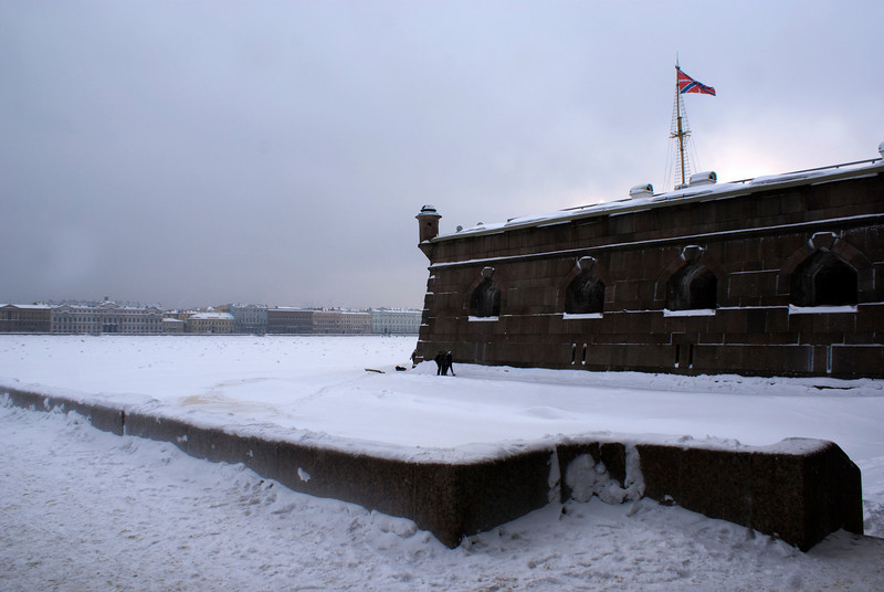 VIEW AT THE FROZEN NEVA FROM THE NEVA GATE OF THE PETER & PAUL FORTRESS. ST. PETERSBURG.