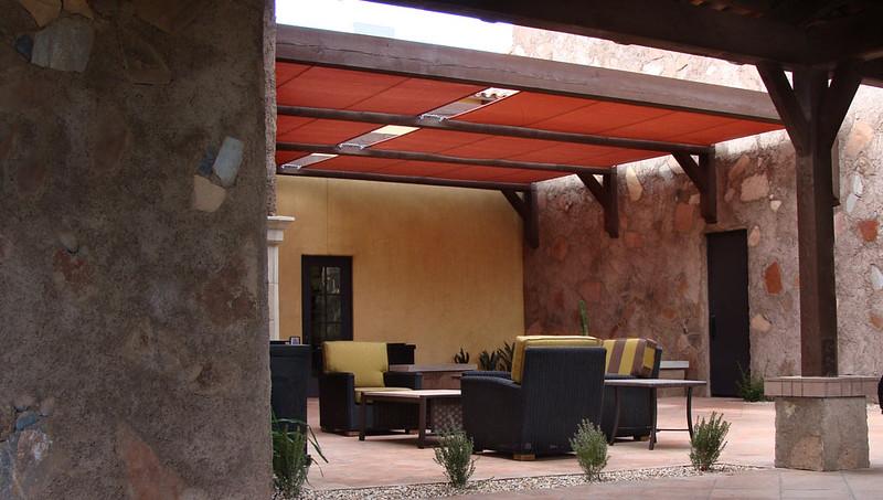 Roman shade covered patio